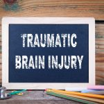 What are the causes and symptoms of traumatic brain injury?